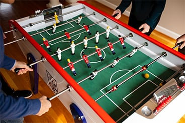 People playing on Foosball table