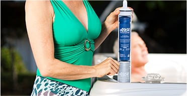 Woman holding spa cleaning product
